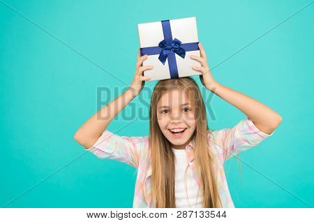 Girl Kid Hold Birthday Gift Box. Every Kid Dream About Such Surprise. Birthday Girl Carry Present. M