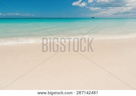 Uninhabited Island. Sand Pearlescent White Claim As Fine As Powder. Clouds Blue Sky Over Calm Sea Be