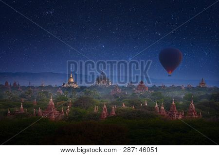 Early Morning In Old Bagan With Overflying Balloon Over The Ancient Temples In The Background Of The