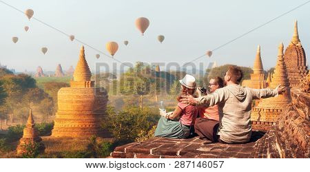 Happy Tourists, Friends, Vacationers In The Summer Holidays In Old Bagan, Myanmar. Young People Havi