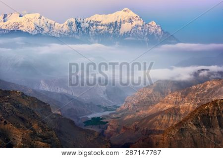 Beautiful View The Canyon And Annapurna Mountain Range In Early Morning On. Upper Mustang, Himalayas