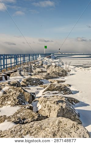 Rocks, Piers, And Navigational Aids At Lake Michigan In Ludington
