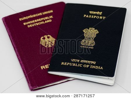 Frankfurt Am Main - December 05 2018; Close Up Of An Indian And German Passport On White Background.