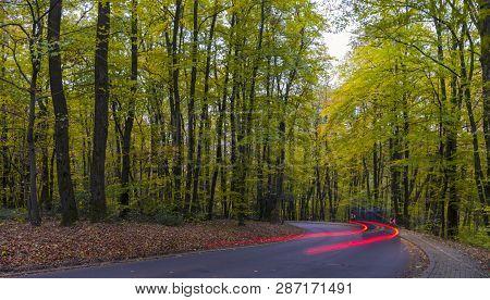 Car Driving Through Autumn, Fall Road. Beauty Nature Scene. Autumn Landscape.