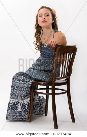 Portrait Of A Pretty Young Girl With Long Ringlets Hair