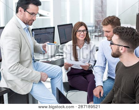Manager and business team talking during a working break