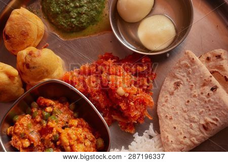 Indian Food Platter Serving Various Flavours From India Consisting Of Mutter Paneer, Chapati Or Roti