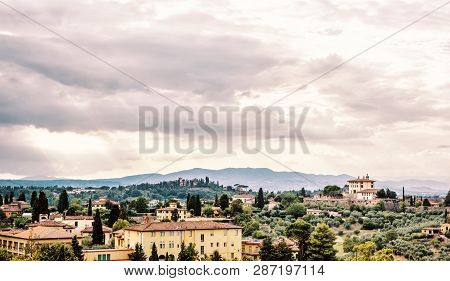 Beautiful Tuscan country. Rural scene. Travel destination. Houses, cypress trees and clouds. Beautiful place. Yellow photo filter. poster