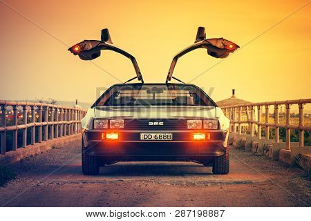 Adelaide, Australia - September 7, 2013: Delorean Dmc-12 Car With Opened Gullwing Doors Parked On Th