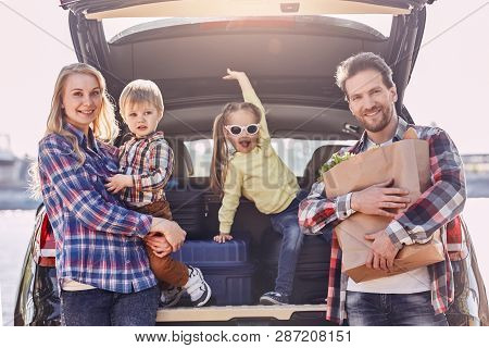 Every Day We Make Deposits In The Memory Banks Of Our Children. Family Stands Near The Car, Looking