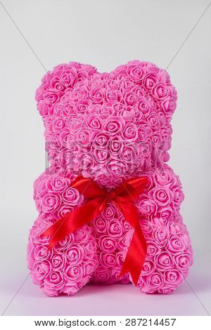 Pink Teddy Bear Toy Of Foamirane Roses. Red Stripe On Teddy Neck. Stock Photo Isolated On White Back