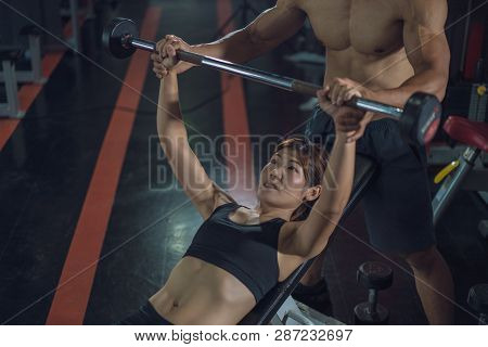Personal Trainer Helping Woman Bench Press In Gym, Training With Barbell, Personal Trainer Helping W