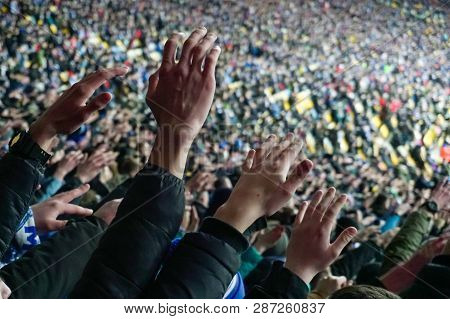 Large Crowd Of Football Fans Clapping Hands, Supporting Their Team. Crowd Of Sports Fans Watching Ga