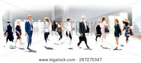 Group Of Business People Walking In The City Of London. Early Morning Rush, Modern Life Concept