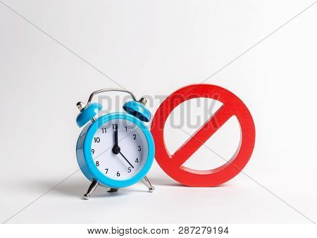 No sign and blue clock on a white background. Unavailability at certain hours. Temporary restrictions and prohibitions. Restrictions and sanctions, strict control. Stop annual watch transfers. poster