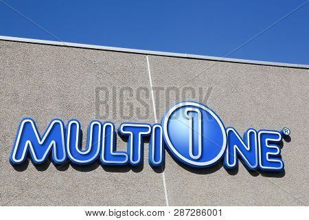 Randers, Denmark - May 5, 2018: Multione Logo On A Wall. Multione Is Designed And Manufactured In It