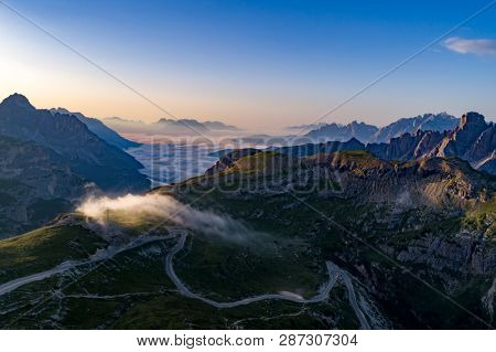 National Nature Park Tre Cime In the Dolomites Alps. Beautiful nature of Italy. Aerial FPV drone flights at sunset