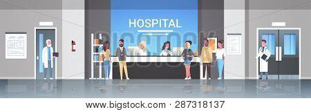 Mix Race Patients Standing Line Queue At Hospital Reception Desk Medical Doctors Consultation Health