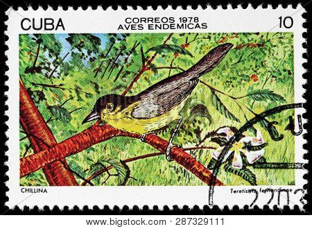 Luga, Russia - February 17, 2019: A Stamp Printed By Cuba Shows Yellow-headed Warbler. It Is Endemic