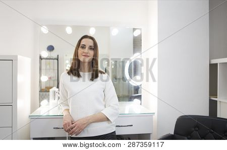 Young Beautiful Smiling Woman Joyfully Looking In Camera Over White Background. Make Up Artist By Th