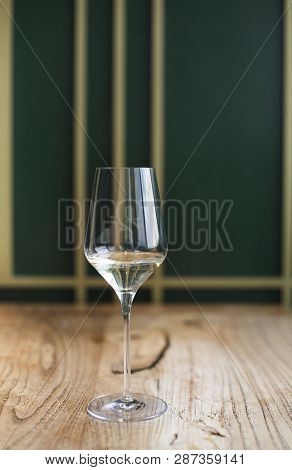 Transparent Drink In Glass Goblet On Wood Background With Natural Light
