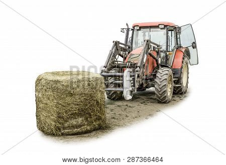 A Tractor With A Front Loader Loads Silage Feed Into An Animal Feed Distributor. Isolated Photo. Nec