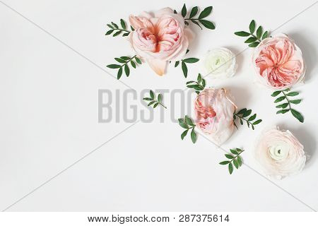 Decorative Corner, Floral Composition With Pink English Roses, Ranunculus And Green Leaves On White