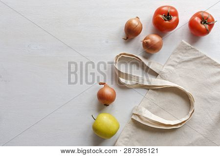 Fresh Fruit And Vegetables With A Natural Fiber Re-usable Shopping Bag Isolated On White As A Side B