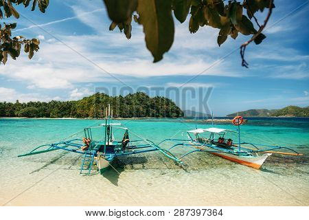 Small Bangka Boats On Beach Of Paradise Island, Port Barton, Philippines