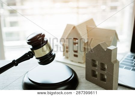 Online Auction for Real Estate home ownership, buying selling or foreclosure concept. Judge gavel house model on computer. Idea for housing business judgment by E-commerce online digital over internet poster