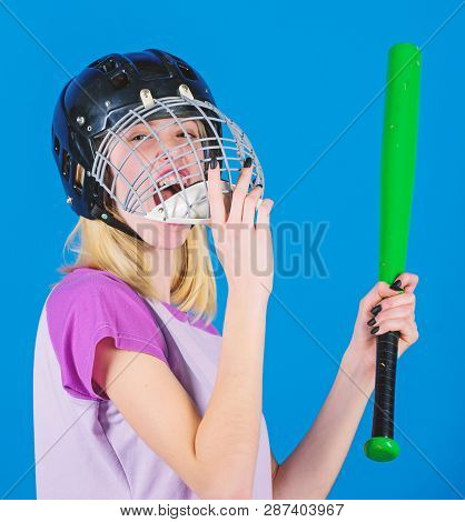 Woman Enjoy Play Baseball Game. Girl Confident Pretty Blonde Wear Baseball Helmet And Hold Bat On Bl