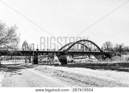 A Street Scene, With The Sarel Cilliers Bridge Over The Vals River, In Kroonstad, A Town In The Free