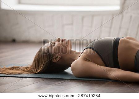 Woman Practicing Yoga, Savasana, Dead Body Pose, Close Up