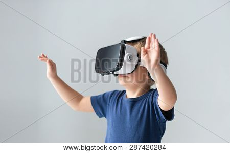 Portrait Of Happy Boy In A Virtual Reality Headset. Attractive Kid Using Vr Goggles At Home. Enterta