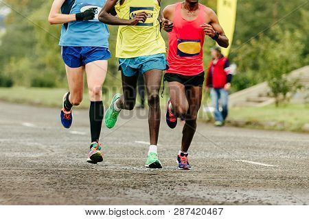 African And European Runners Athletes Running Marathon In Group