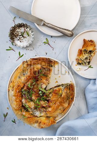 Greek Pie Spanakopita On Light Blue Background. Ideas And Recipes For Vegetarian Or Vegan Spinach Pi