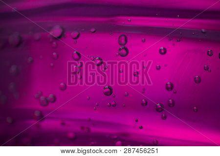 Bubbles In A Pink Oil Liquid