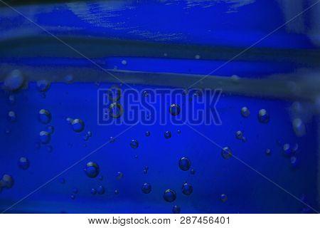 Bubbles In A Blue Oil Liquid