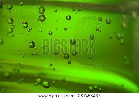 Bubbles In A Green Oil Liquid