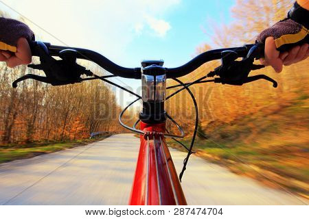 Riding Mountainbike On A Asphalt Road In Nature
