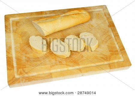 Wooden plate with french bread