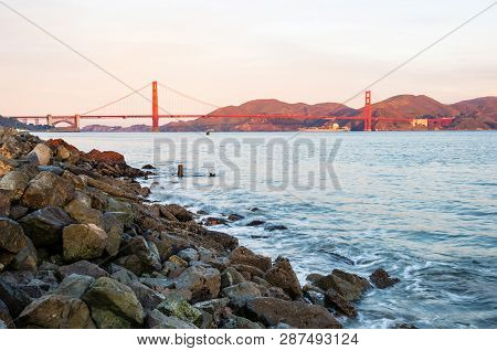 Golden Gate Bridge, The Most Recognized Symbol Of San Francisco, In Warm Red Color Of Aurora
