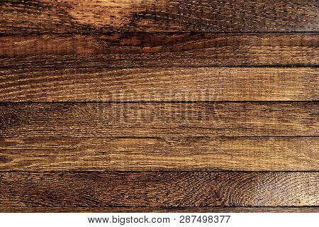 Horizontal Dark Wooden Table Background. Old Brown Burnt Oak. Top View. Copy Space. Close Up. Natura