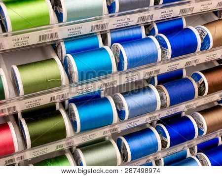 Spools Of Sulky Thread And Trademark Logo