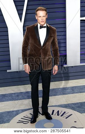 BEVERLY HILLS - FEB 24: Sam Heughan at the 2019 Vanity Fair Oscar Party at The Wallis Annenberg Center for the Performing Arts on February 24, 2019 in Beverly Hills, CA