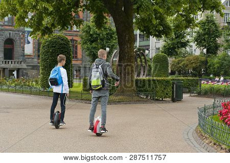 Bergen, Norway - July 21, 2018: Two Young Boys Riding The One Wheel The Onewheel  In Bergen