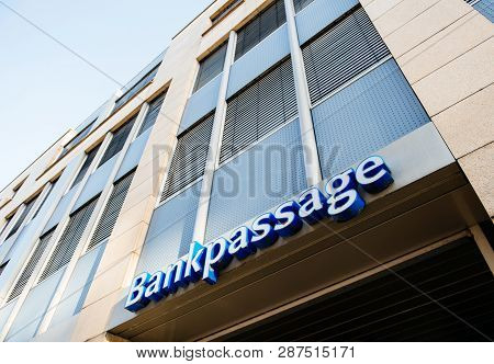 Karlsruhe, Germany - Oct 29, 2017: Bankpassage Sign On The Bank Building - Low Angle View Of Modern