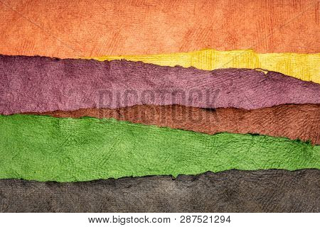 abstract landscape created with sheets of textured colorful handmade paper