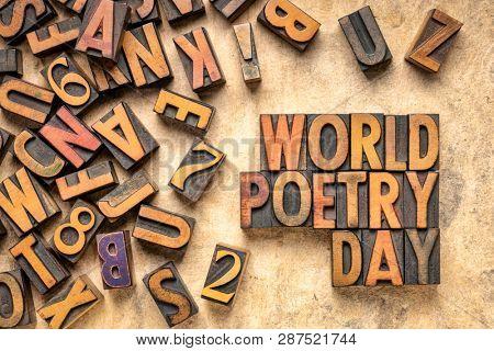world poetry day - word abstract in vintage letterpress wood type printing blocks