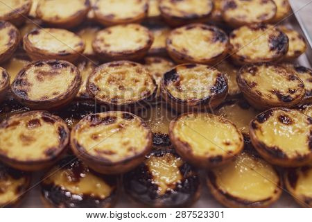 Rows Of Delicious Portuguese Pastel De Nata (sweet Egg Yolk Tarts) In Lisbon